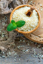 Bowl of white long grain rice on the old sacking. Royalty Free Stock Photo