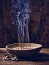 Bowl wood joss stick cymbal with lit on and Royalty Free Stock Images