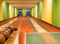 Bowling alley with balls Royalty Free Stock Photo