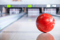 Bowling ball with pins going down the lane in a five pin alley Stock Photos