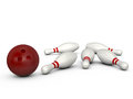 Bowling ball and pins red crashed to white isolated on white background Royalty Free Stock Image