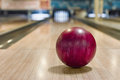 Bowling ball on the track red in game center Royalty Free Stock Image