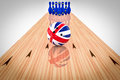 Bowling ball with the United Kingdom flag and bowling pins with the European Community flag Royalty Free Stock Photo