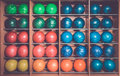 Bowling balls in the rack, sorted by color