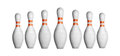 Bowling pins in a row isolated on white Royalty Free Stock Photos
