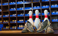 Bowling shoes and pins Royalty Free Stock Photo