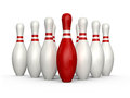 Bowling skittles red pin standing out from the crowd front of other isolated on white background Royalty Free Stock Photos