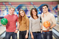 In bowling smiling young people Stock Photography