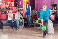 Bowling young people play the Royalty Free Stock Images