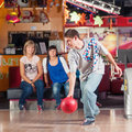 Bowling young people play the Royalty Free Stock Image