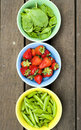 Bowls with fresh vegetables and fruit Royalty Free Stock Photo