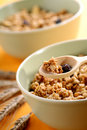 Bowls full of musli with milk, healthy breakfast Royalty Free Stock Images