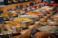 Bowls of seasonings rows filled with curry powder and spices for sale gritty processing Stock Photo
