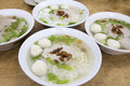 Bowls of southeast asian fishball noodle soup with pork patty and pork lard Royalty Free Stock Photos