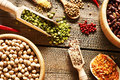 Bowls and spoons of various legumes Royalty Free Stock Photo