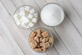 Bowls of sugar three glass filled with granulated white cubes and natural chunks high angle view on a rustic wood kitchen Royalty Free Stock Image