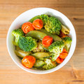 Bowls of variety vegetables on table Stock Photography