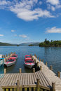 Bowness on Windermere Cumbria UK with pleasure motor boats and jetty Royalty Free Stock Photo