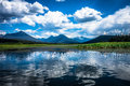 Bowron lakes view day shot of and marsh canada cumulus clouds mirror in lake Royalty Free Stock Photo