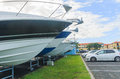 The bows of boats sticking out of the rack for storing stand in front of cars horizontal photo photo took new zealand photo is Stock Images
