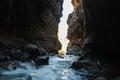 Box canyon light peaking through the dark at falls near ouray colorado Stock Image