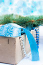 Box with Christmas toys, blue and silver beads, blue ribbon and Royalty Free Stock Photo