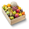 Box of fresh fruit a wood full whole on a white background Stock Photos