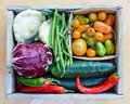 Box of fresh vegetables wooden full veggies Royalty Free Stock Photo