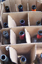 Box full of empty wine bottles rows in a cardboard Royalty Free Stock Photo