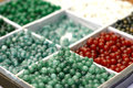 Box of jewellery beads closeup sorted into different compartments Royalty Free Stock Photography