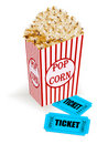 Box with popcorn and movie tickets Royalty Free Stock Photo