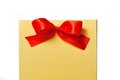 Box with a red bow festive gold on white background Royalty Free Stock Images