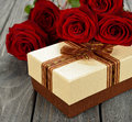 Box and red roses on a gray background Stock Photography