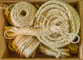 Box of rope and twine a various ropes some rolled Stock Image