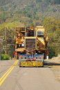 Box scraper move lowboy moving a large scaper from a construction site in roseburg oregon Stock Image