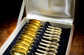 Box of vintage gold-plated teaspoons Royalty Free Stock Photos