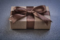 Boxed gift with brown bow on grey background top view celebratio celebrations concept Royalty Free Stock Photos