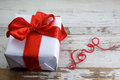 Boxed gift on wooden background Stock Images