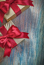 Boxed gifts with red bows on vintage wooden board celebration co concept Stock Image