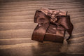 Boxed glittery gift container on vintage wooden board Royalty Free Stock Image