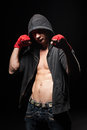 Boxer in black hood Stock Photography