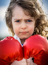 Boxer child wearing red boxing gloves Royalty Free Stock Images