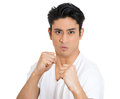 Boxer closeup portrait hostile angry irritated upset young man raising shaking fists at you to camera gesture isolated white Royalty Free Stock Photos