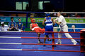 Boxer falls during Olympic bout Royalty Free Stock Photography