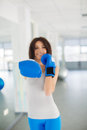Boxer fitness woman boxing wearing boxing gloves instructor punching fun and fresh towards camera beautiful mixed Stock Images