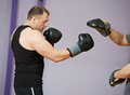 Boxer man at boxing training with punch mitts Royalty Free Stock Photos