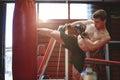 Boxer practicing kickboxing Royalty Free Stock Photo