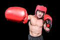 Boxer punching against black background with red headgear Stock Photography
