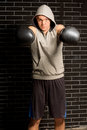 Boxer punching with both fists towards the camera Royalty Free Stock Photo