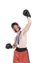 Boxer wearing gold medal performing boxing stance Royalty Free Stock Photo
